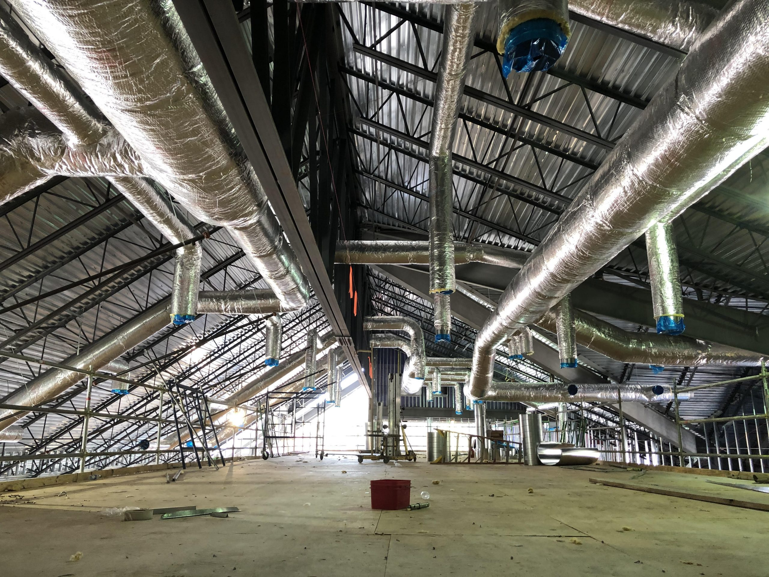 A view of HVAC being installed in the Ministry Center from the top of the scaffolding